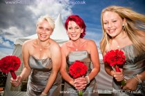 Yorkshire bridesmaids with red bouquets