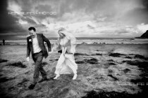 Newlyweds running frm rain Scarborough