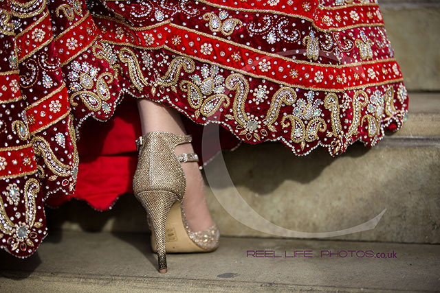 Bride's shoe and lengha at Asian wedding in Dewsbry